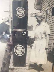 Elsie Stuber pumps gas at her Linwood general store in Atlantic County. Before Elsie's came to Haddon Township, the pickle sandwich named after Stuber was born in what had been her general store.