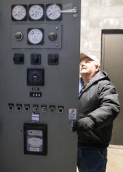 Revis Osborne inspects one of the many equipment control boxes that need repair thorough the wastewater treatment plant