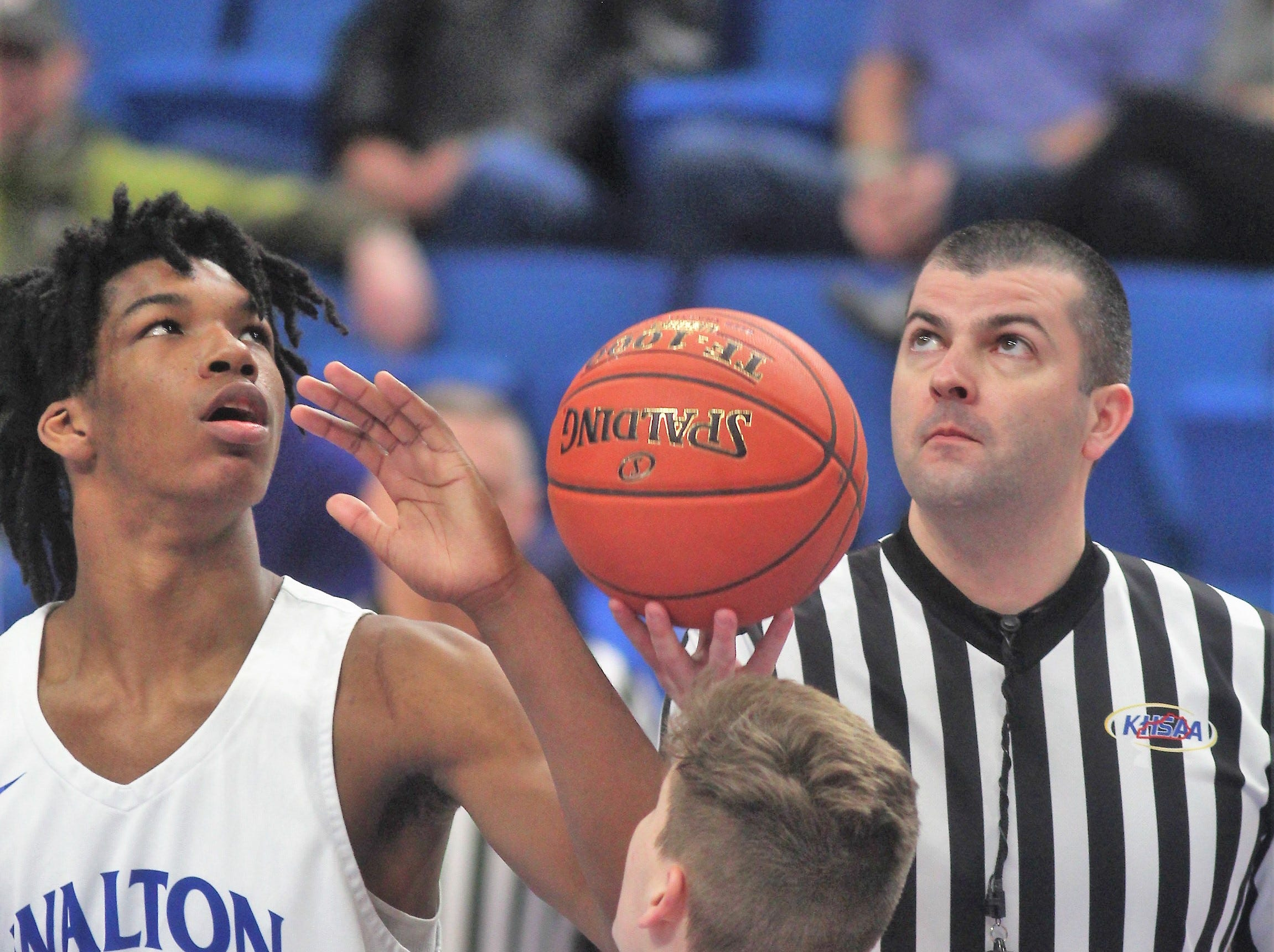 Walton-Verona senior Dieonte Miles, left, and Campbell County senior Reid Jolly get set for the opening tip as Campbell County defeated Walton-Verona 49-42 in the state quarterfinals of the Whitaker Bank/KHSAA Boys Basketball Sweet 16 March 8, 2019, at Rupp Arena.