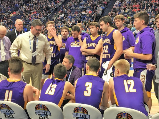 Campbell County head coach Aric Russell talks to the Camels as Campbell County defeated Walton-Verona 49-42 in the state quarterfinals of the Whitaker Bank/KHSAA Boys Basketball Sweet 16 March 8, 2019, at Rupp Arena.