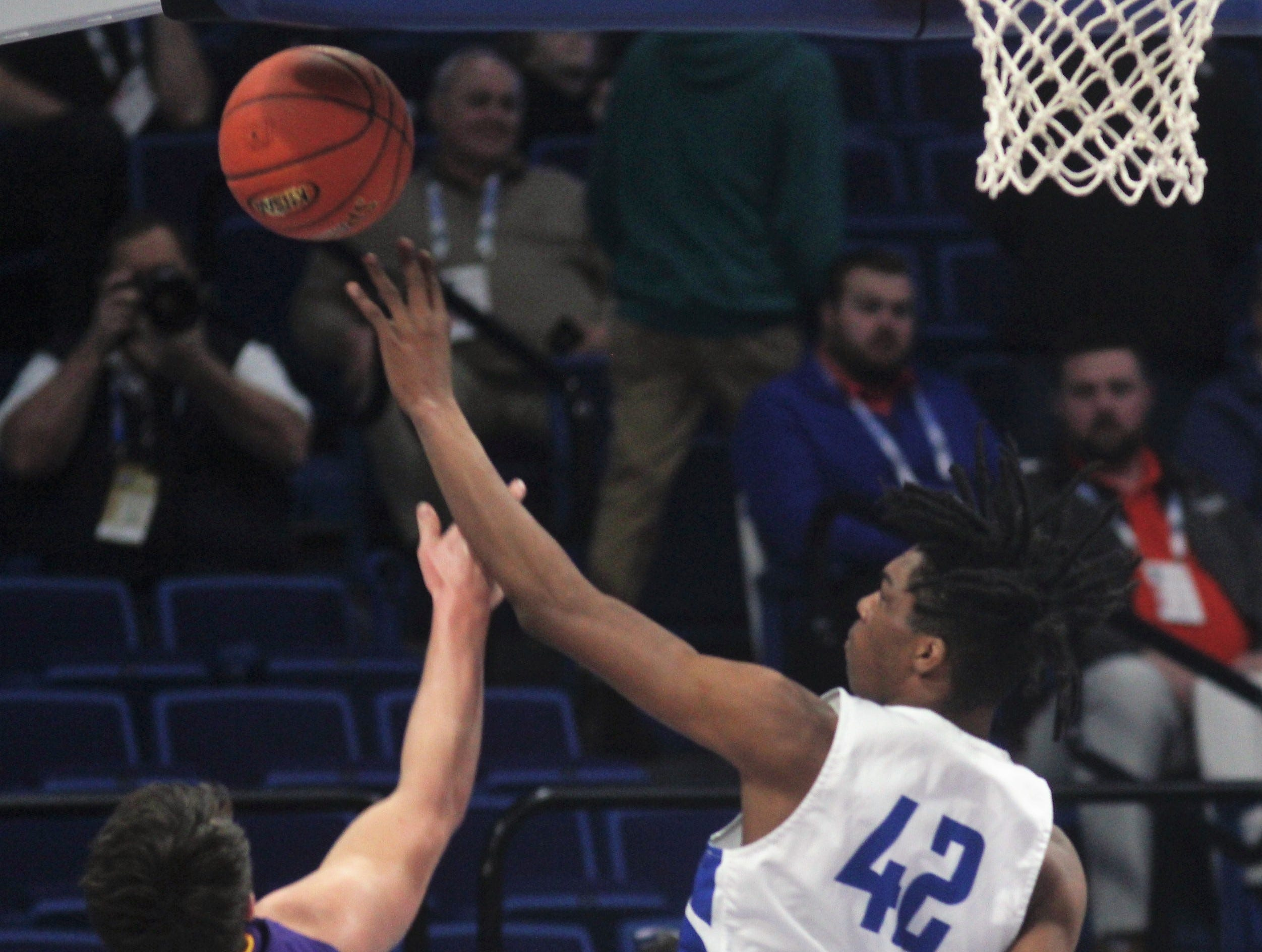 Walton-Verona senior Dieonte Miles collects one of his Sweet 16-record 12 blocked shots, sending away a shot by Tanner Lawrence as Campbell County defeated Walton-Verona 49-42 in the state quarterfinals of the Whitaker Bank/KHSAA Boys Basketball Sweet 16 March 8, 2019, at Rupp Arena.