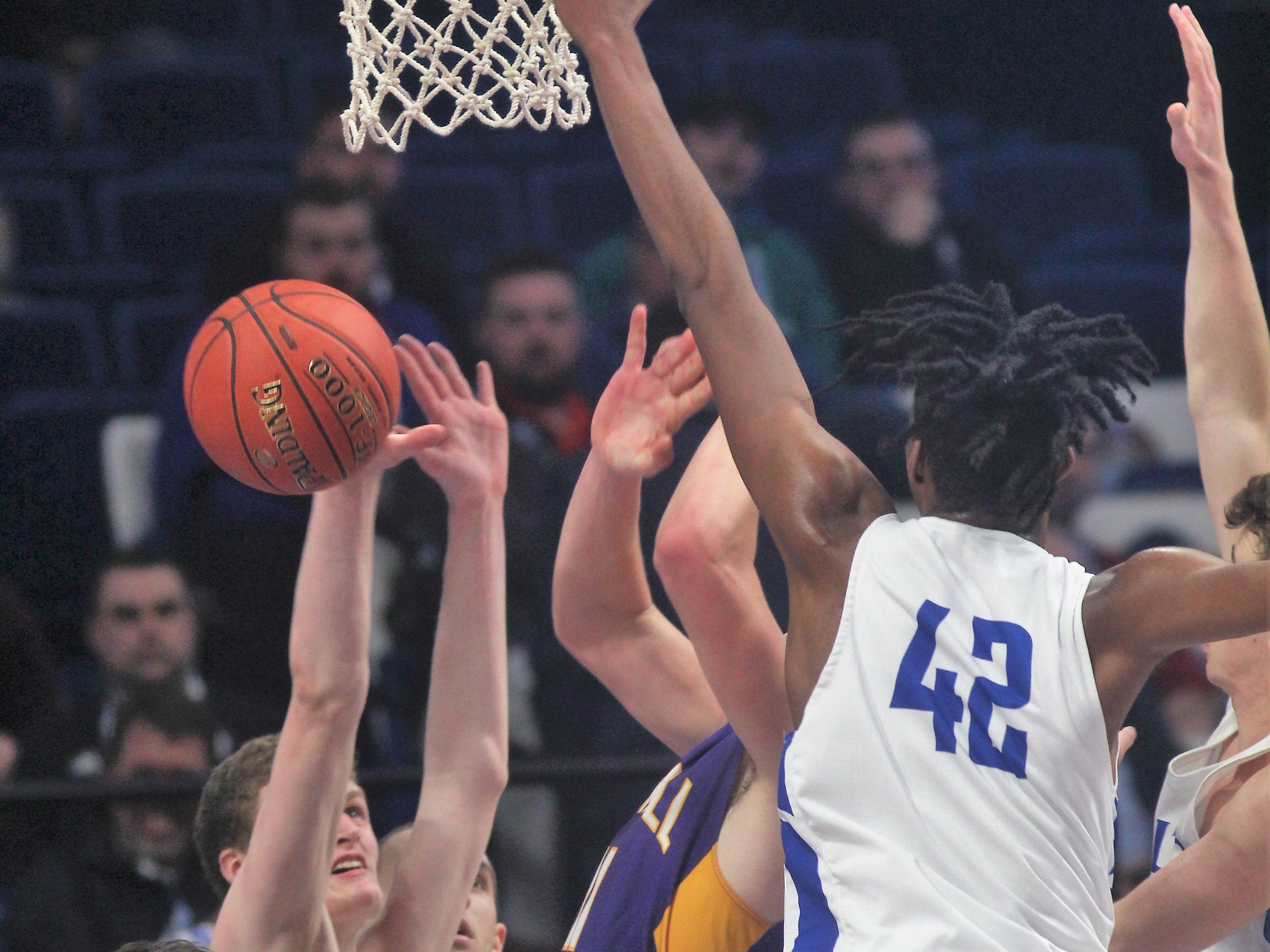 Walton-Verona and Campbell County players battle for the ball as Campbell County defeated Walton-Verona 49-42 in the state quarterfinals of the Whitaker Bank/KHSAA Boys Basketball Sweet 16 March 8, 2019, at Rupp Arena.