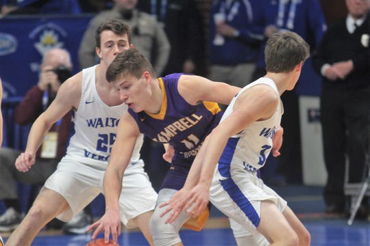 Campbell County senior Reid Jolly tries to split two Walton-Verona defenders as Campbell County defeated Walton-Verona 49-42 in the state quarterfinals of the Whitaker Bank/KHSAA Boys Basketball Sweet 16 March 8, 2019, at Rupp Arena.
