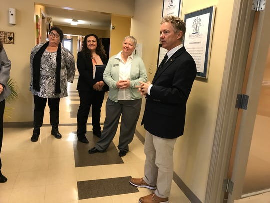 Sen. Rand Paul talks with workers at Brighton Recovery Center for women in Florence on Friday