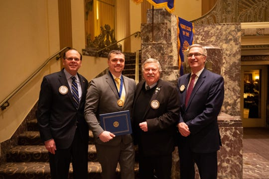 Rotary Club of Cincinnati President Rick Flynn of Evendale, with 2019 Cincinnati Jefferson Award winner Tim Arnold of Northside, Rotary award chair Bill Shula of Bethel, and Rotary member Doug Adams of Mariemont, a past national Jefferson Award winner.