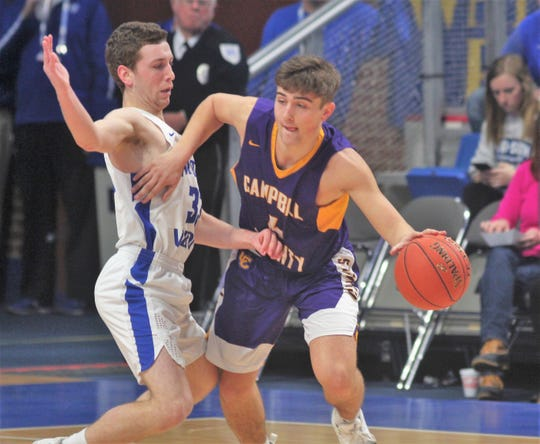 Walton-Verona senior Grant Grubbs gets in the grill of Campbell County senior Drew Wilson as Campbell County defeated Walton-Verona 49-42 in the state quarterfinals of the Whitaker Bank/KHSAA Boys Basketball Sweet 16 March 8, 2019, at Rupp Arena.