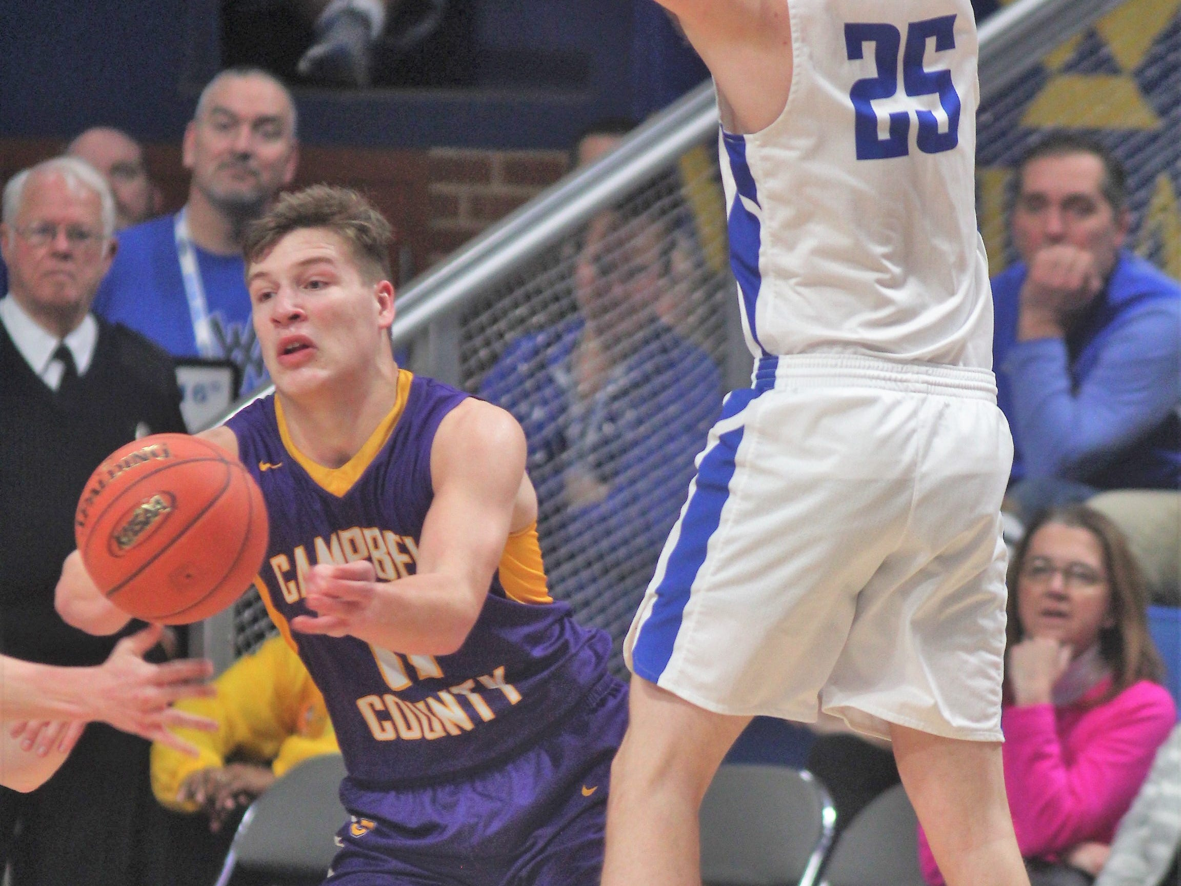 Campbell County senior Reid Jolly gets the ball as Walton-Verona senior Kameron Pardee tries to distract him as Campbell County defeated Walton-Verona 49-42 in the state quarterfinals of the Whitaker Bank/KHSAA Boys Basketball Sweet 16 March 8, 2019, at Rupp Arena.