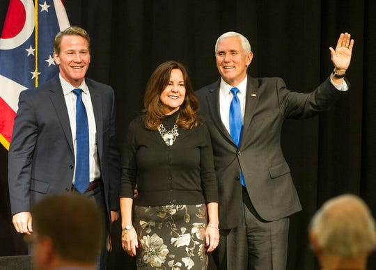 Ohio Lt. Governor Jon Husted stands with Karen Pence and Vice President Mike Pence at the Ohio Oil and Gas Association's annual meeting Friday in Columbus.
