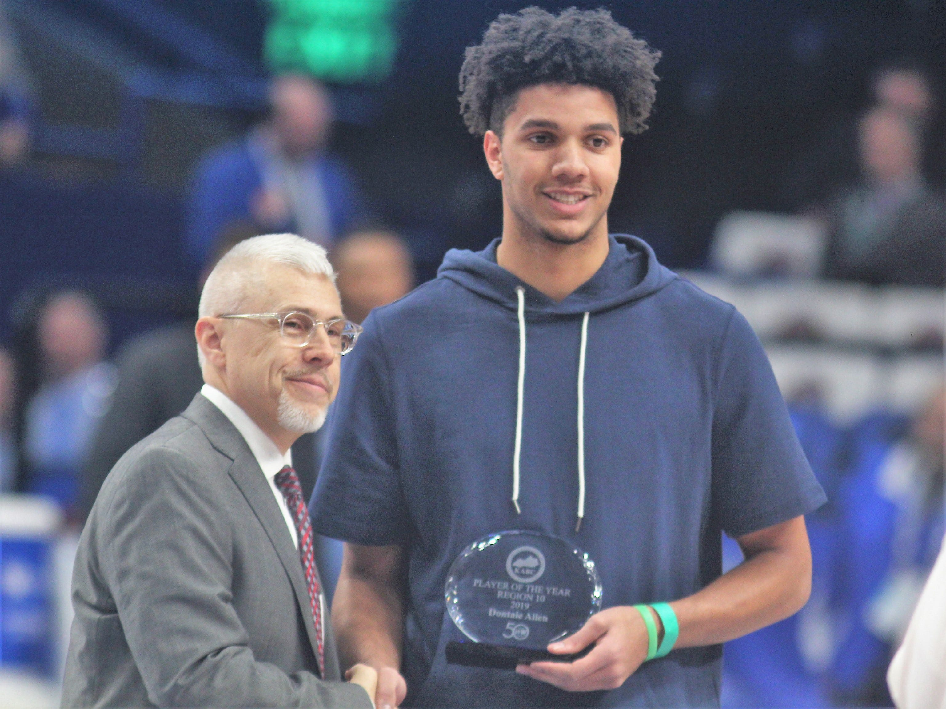 Pendleton County senior Dontaie Allen accepts his KABC 10th Region Player of the Year honor as Campbell County defeated Walton-Verona 49-42 in the state quarterfinals of the Whitaker Bank/KHSAA Boys Basketball Sweet 16 March 8, 2019, at Rupp Arena.
