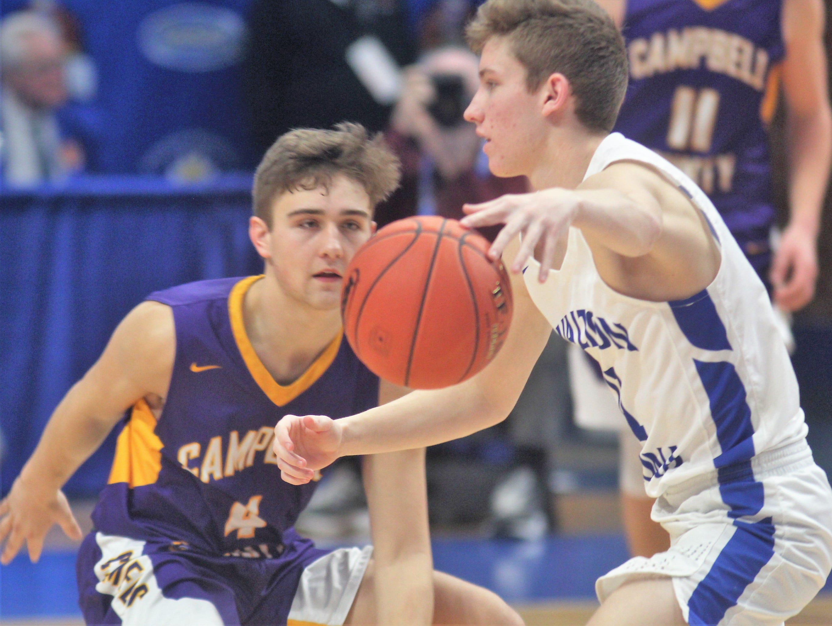 Campbell County senior Drew Wilson keeps an eye on Walton-Verona senior Trey Bonne as Campbell County defeated Walton-Verona 49-42 in the state quarterfinals of the Whitaker Bank/KHSAA Boys Basketball Sweet 16 March 8, 2019, at Rupp Arena.