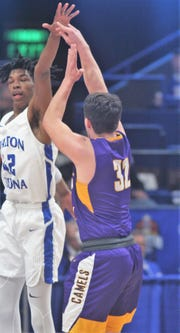 Walton-Verona senior Dieonte Miles tries to block the shot of Campbell County senior Tanner Lawrence.