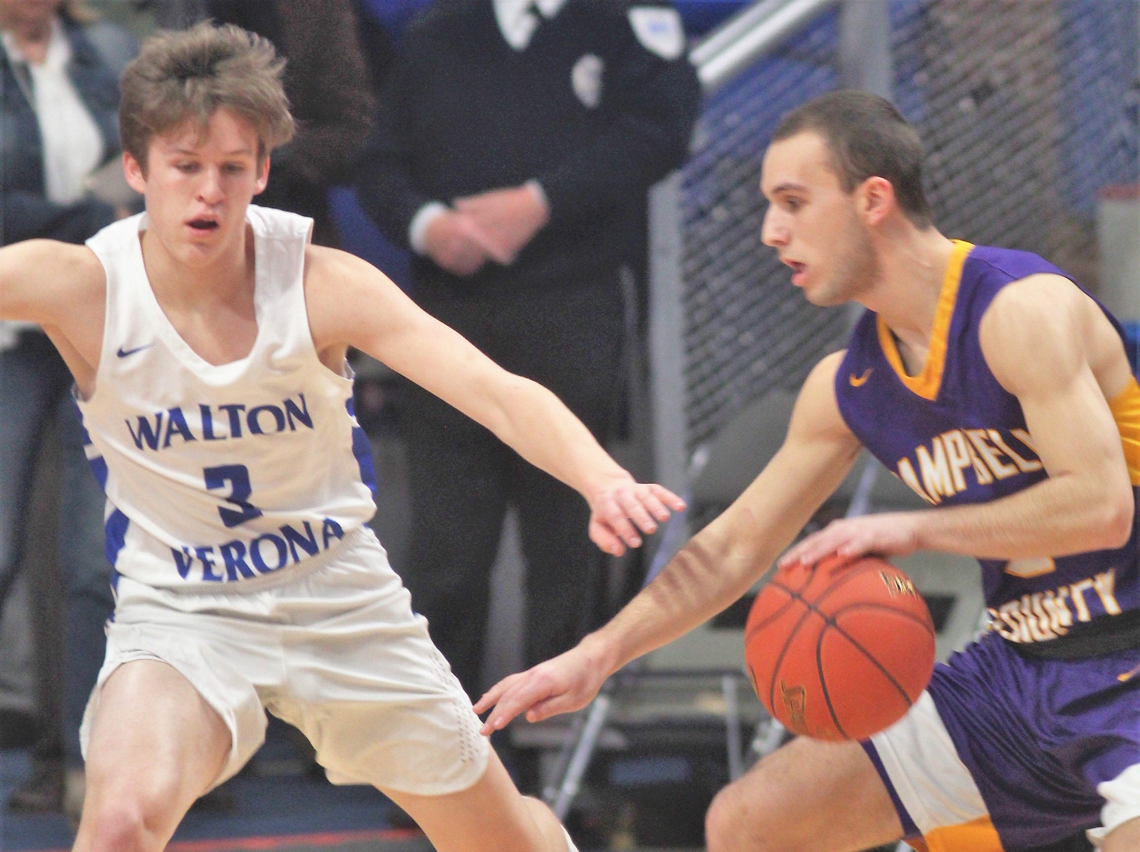 Walton-Verona senior Garrett Jones keeps an eye on Campbell County senior Noah Wirth as Campbell County defeated Walton-Verona 49-42 in the state quarterfinals of the Whitaker Bank/KHSAA Boys Basketball Sweet 16 March 8, 2019, at Rupp Arena.