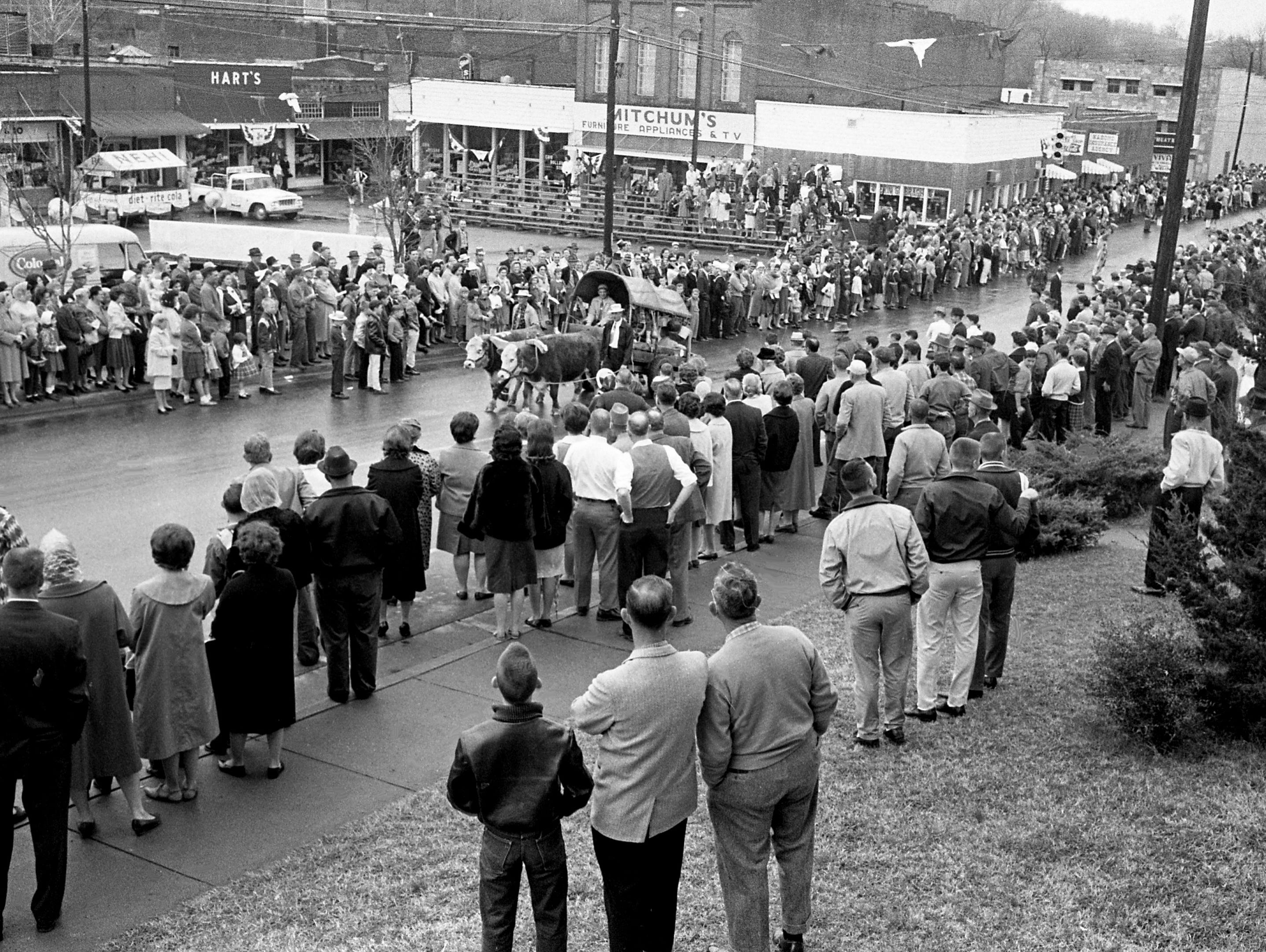 "A crowd with at least 5,000 lines the main street of Erin, Tenn. March 14, 1964 for the parade during the second annual Wearing of the Green celebration. Erin is the only town in America to bear the name of the ""auld sod."""