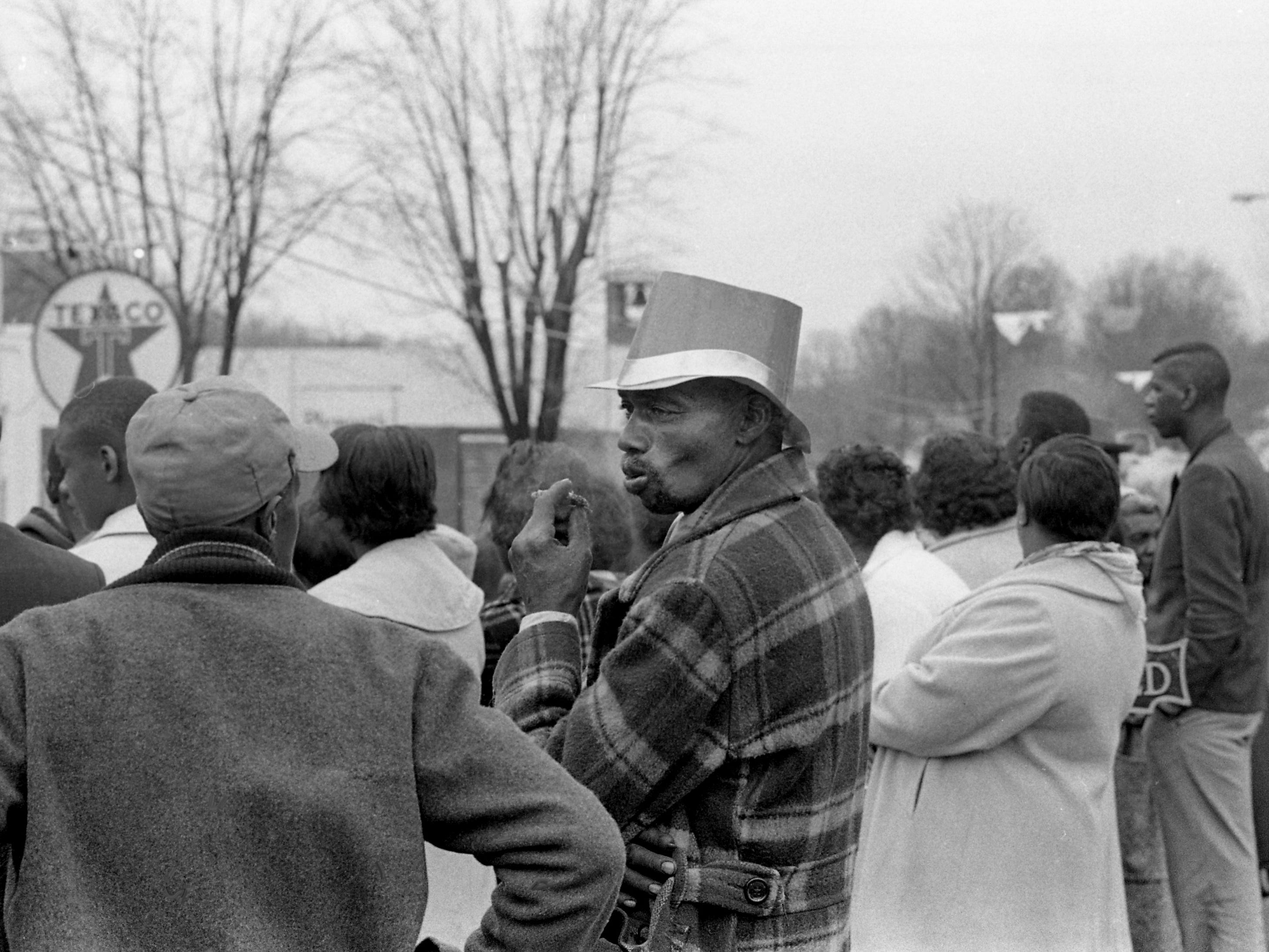 The luck of the Irish held in the face of threatening thunderstorms throughout the day, as some folks enjoy the parade of the second annual Wearing of the Green celebration in Erin, Tenn. March 14, 1964.