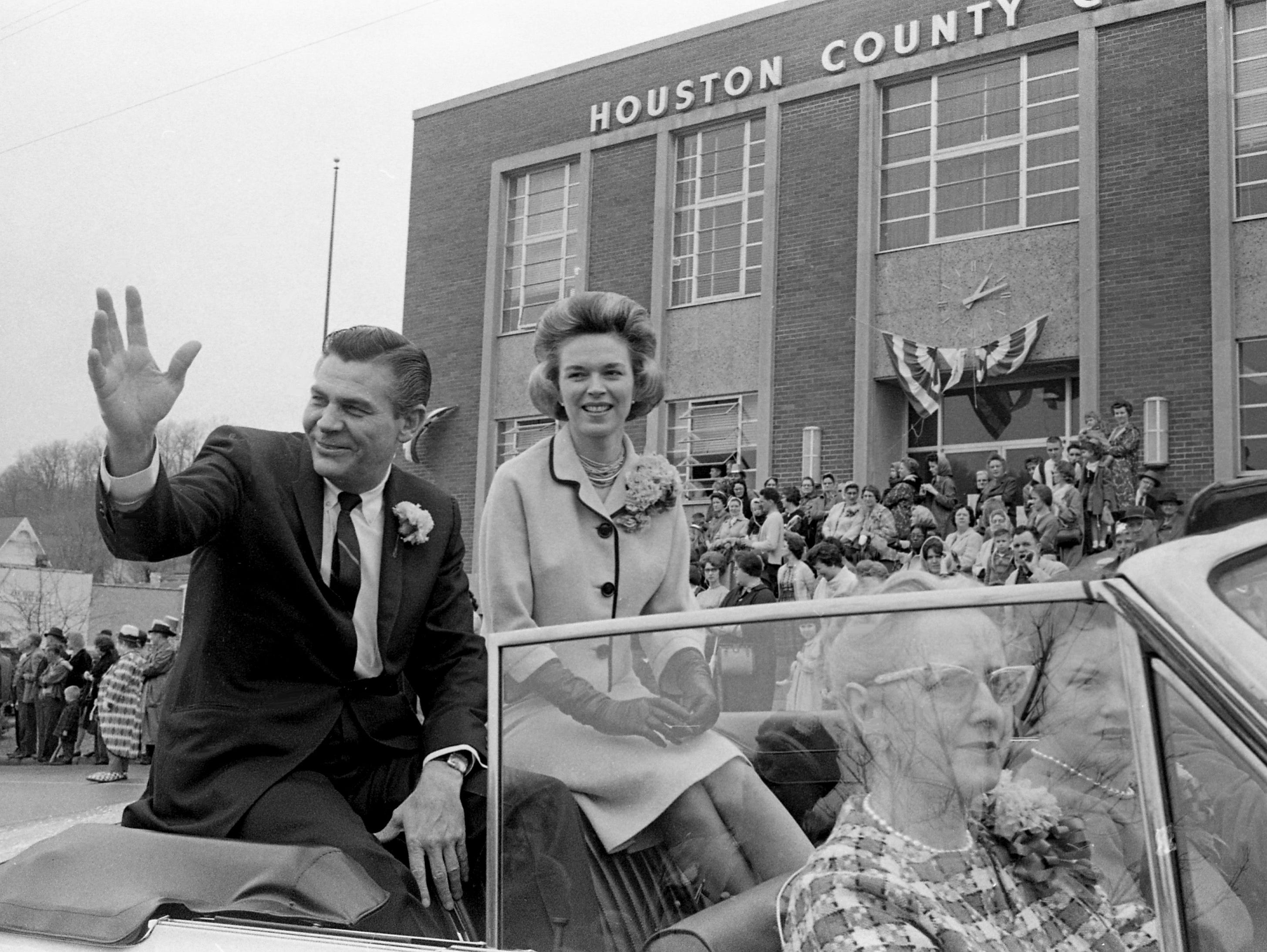 Congressman Ross Bass, with wife Avanell, waves to the crowd as they ride in the parade of the second annual Wearing of the Green celebration in Erin, Tenn. March 14, 1964. The event was dedicated to Rep. Bass, who Sixth District includes Houston County where Erin is located.