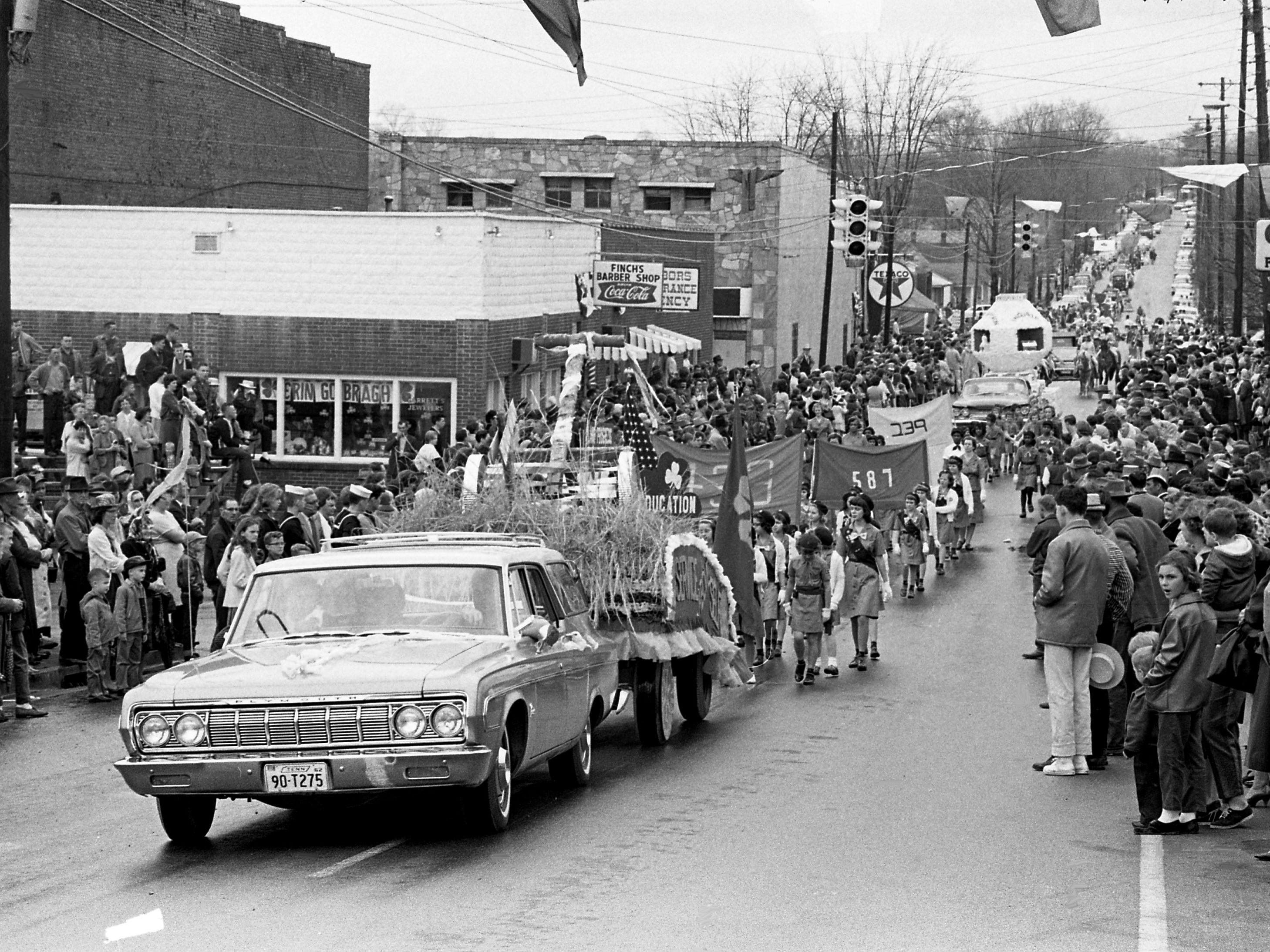 "A crowd of at least 5,000 lines the main street of Erin, Tenn., March 14, 1964, for the parade during the second annual Wearing of the Green celebration. Erin is the only town in America to bear the name of the ""auld sod."""