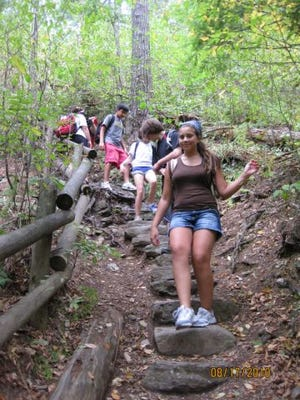 Xtreme Adventurers enjoy a day of hiking in the woods.
