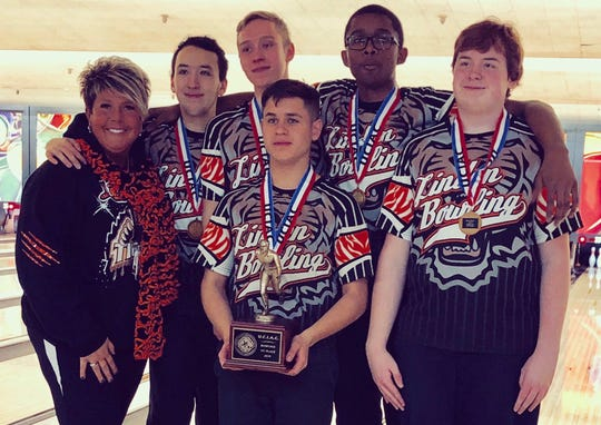 Linden coach Cherie Pizzano (left) with her bowling team after they won the Union County championship this season. From left are Matt Soto, Anthony Golabek, James Fitz, Darius Lewis and Justin Peters.