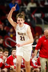 Waukee's Payton Sandfort (21) celebrates a three-point shot during their boys 4A state semi-final basketball tournament game on Thursday, March 7, 2019 in Des Moines. Dubuque Senior takes a 23-19 lead over Waukee into halftime.