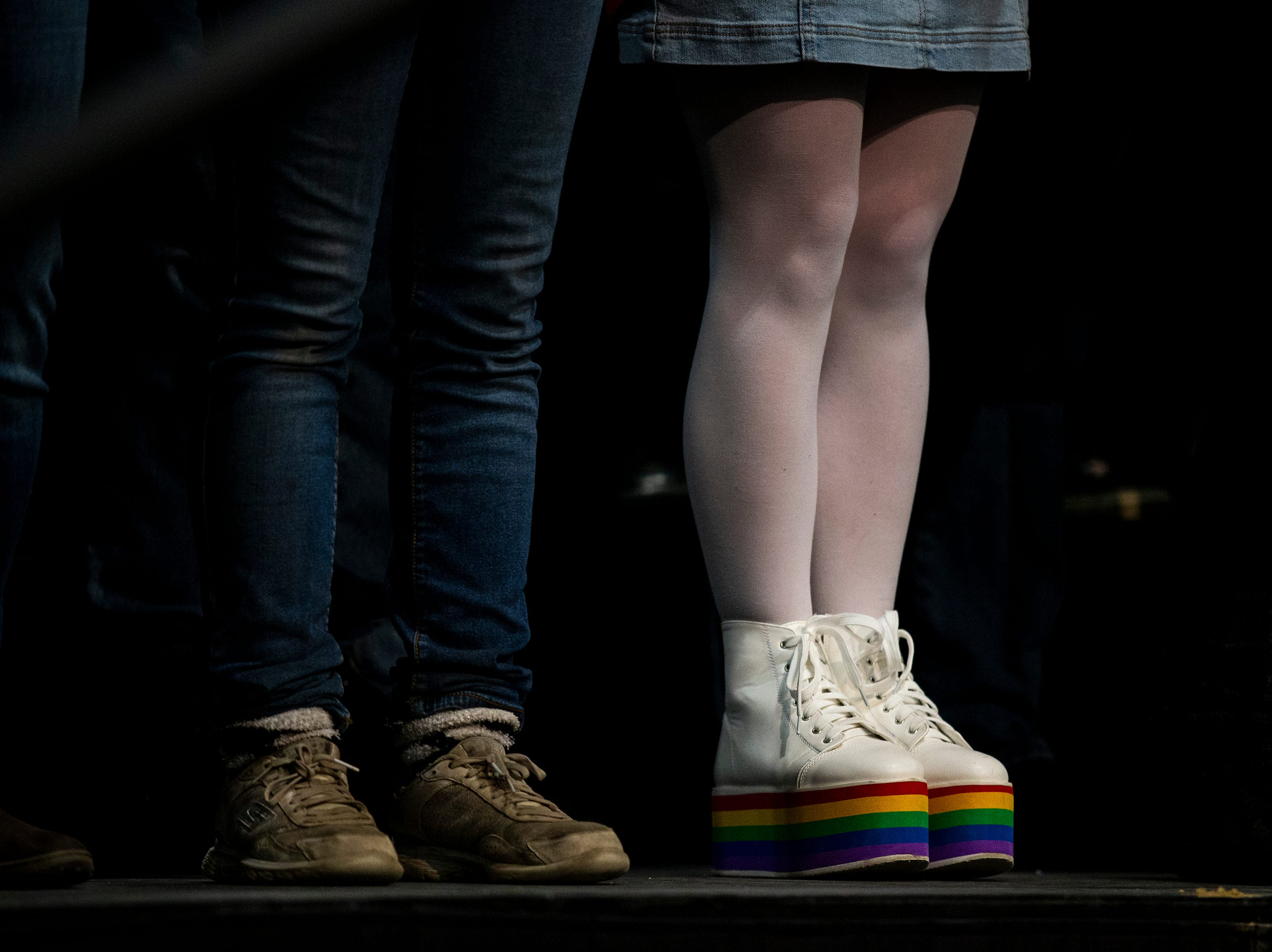 A woman in the crowd wears rainbow boots to Sen. Bernie Sanders', I-VT, first rally in Iowa after announcing he'll run for president for the second time, on Thursday, March 7, 2019, in Council Bluffs.