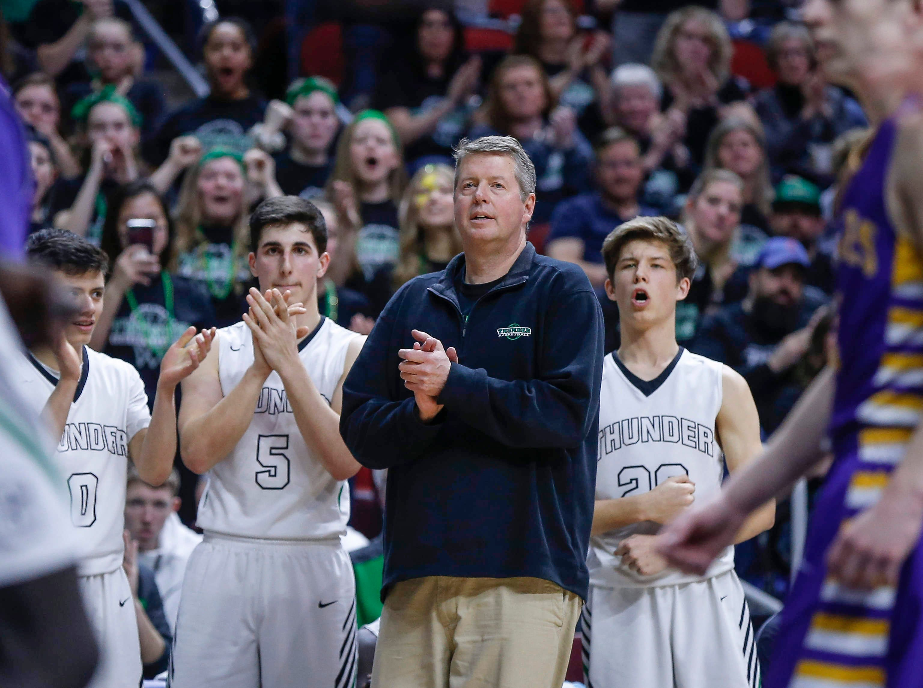 Grand View Christian head boys basketball coach David Stubbs and the Thunder bench react to a foul called against Alburnett during the Class 1A boys state basketball championship game against Alburnett on Friday, March 8, 2019, at Wells Fargo Arena in Des Moines.