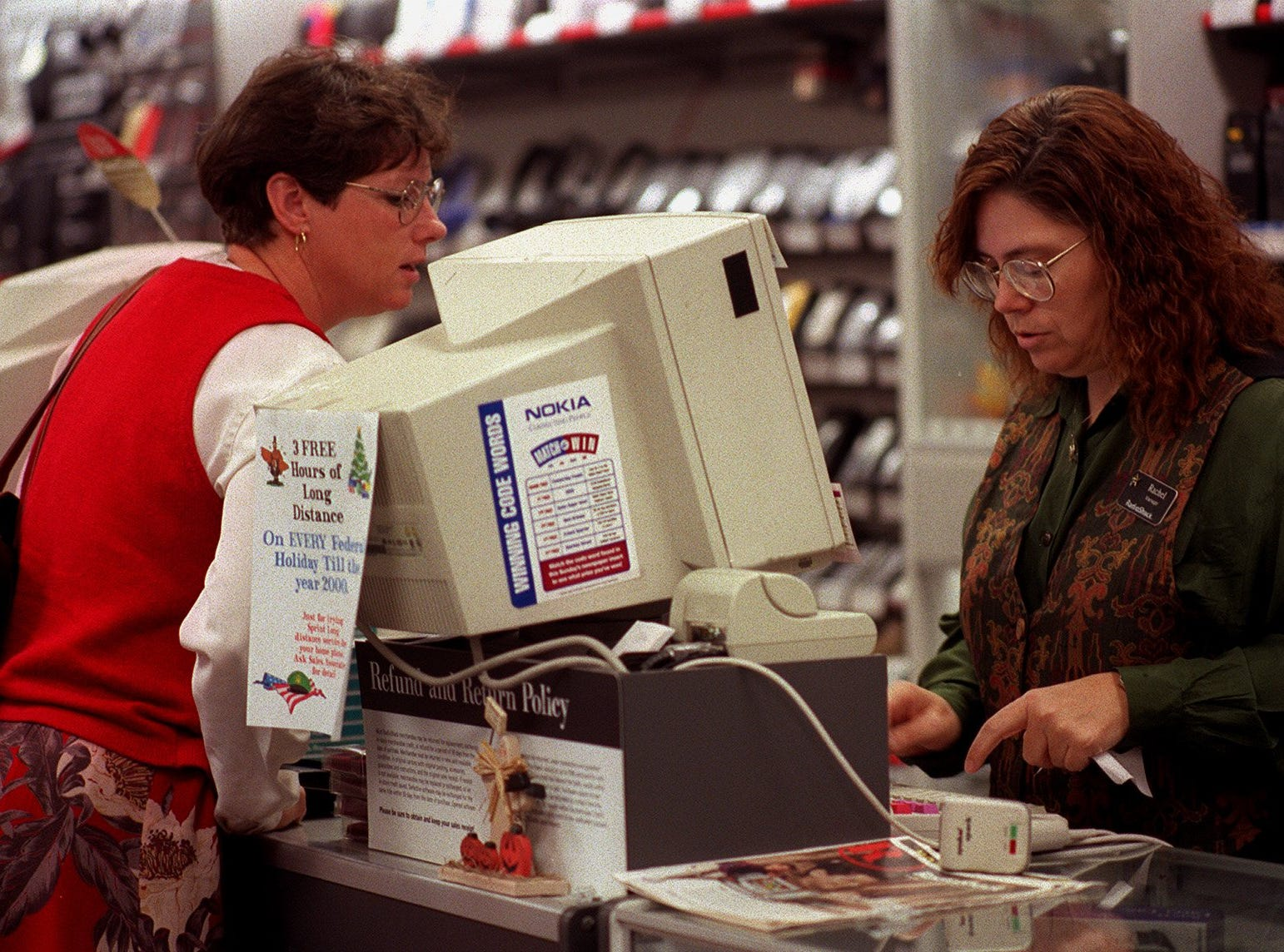 Maureen Sedlacek of Keosauqua looks over at Rachel Eveland,manager of Radio Shack, as Eveland gets some information from her. Sedlacek was picking up some accessories for her computer at Radio Shack which is located in the Valley West Mall in West Des Moines on Oct. 28, 1998.