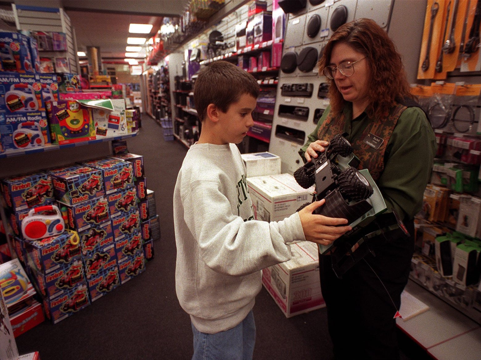 Daniel Schuelzky, 10, of West Des Moines takes a look at a radio controlled car that Rachel Eveland, manager of Radio Shack, was showing him on Oct. 28, 1998.