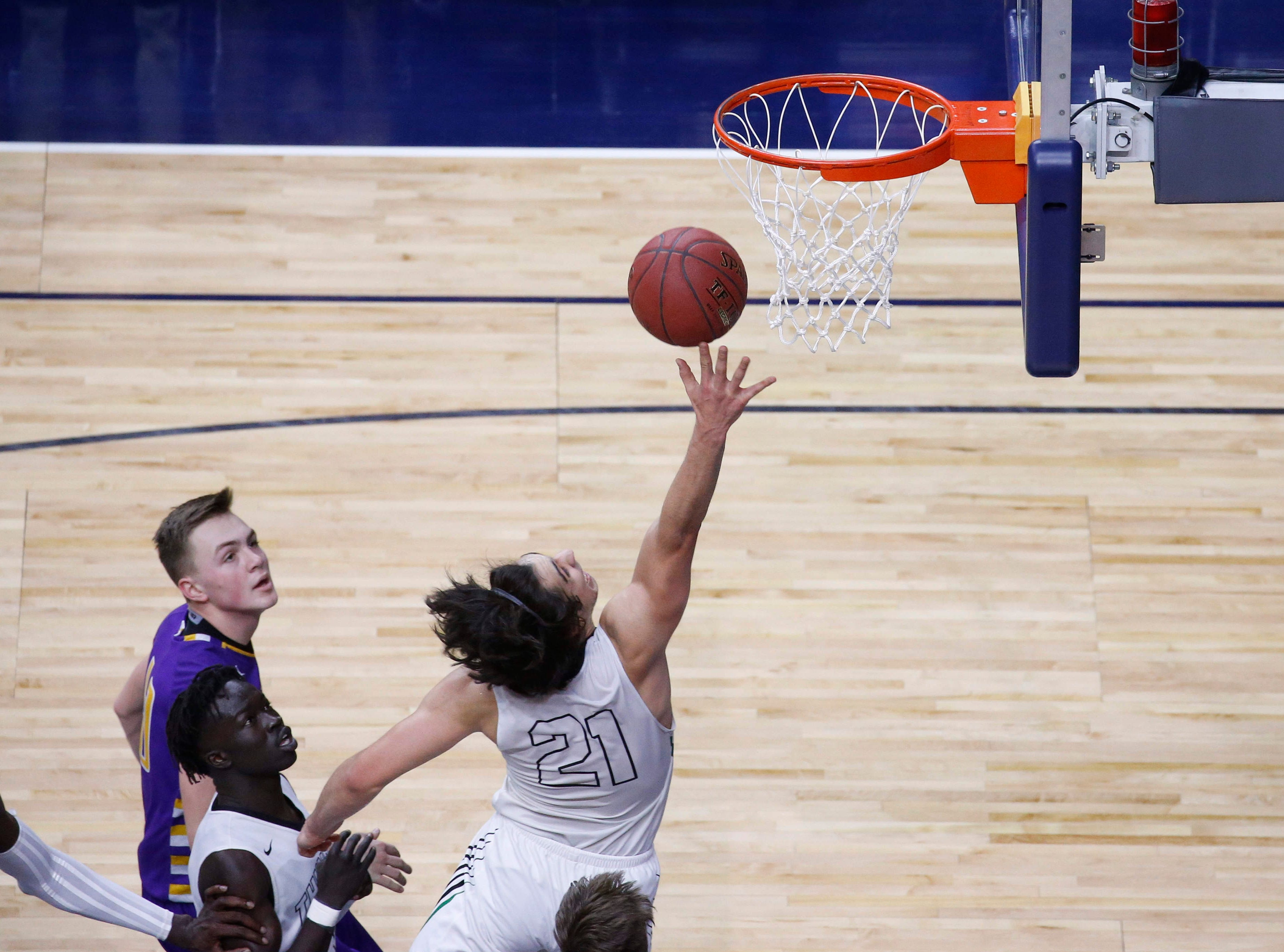 Grand View Christian senior Arturo Montes drives the lane against Alburnett in the first quarter during the Class 1A boys state basketball championship game on Friday, March 8, 2019, at Wells Fargo Arena in Des Moines.