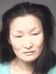 Meirong Li, Hart's wife, also faces felony charges of human trafficking and pimping.