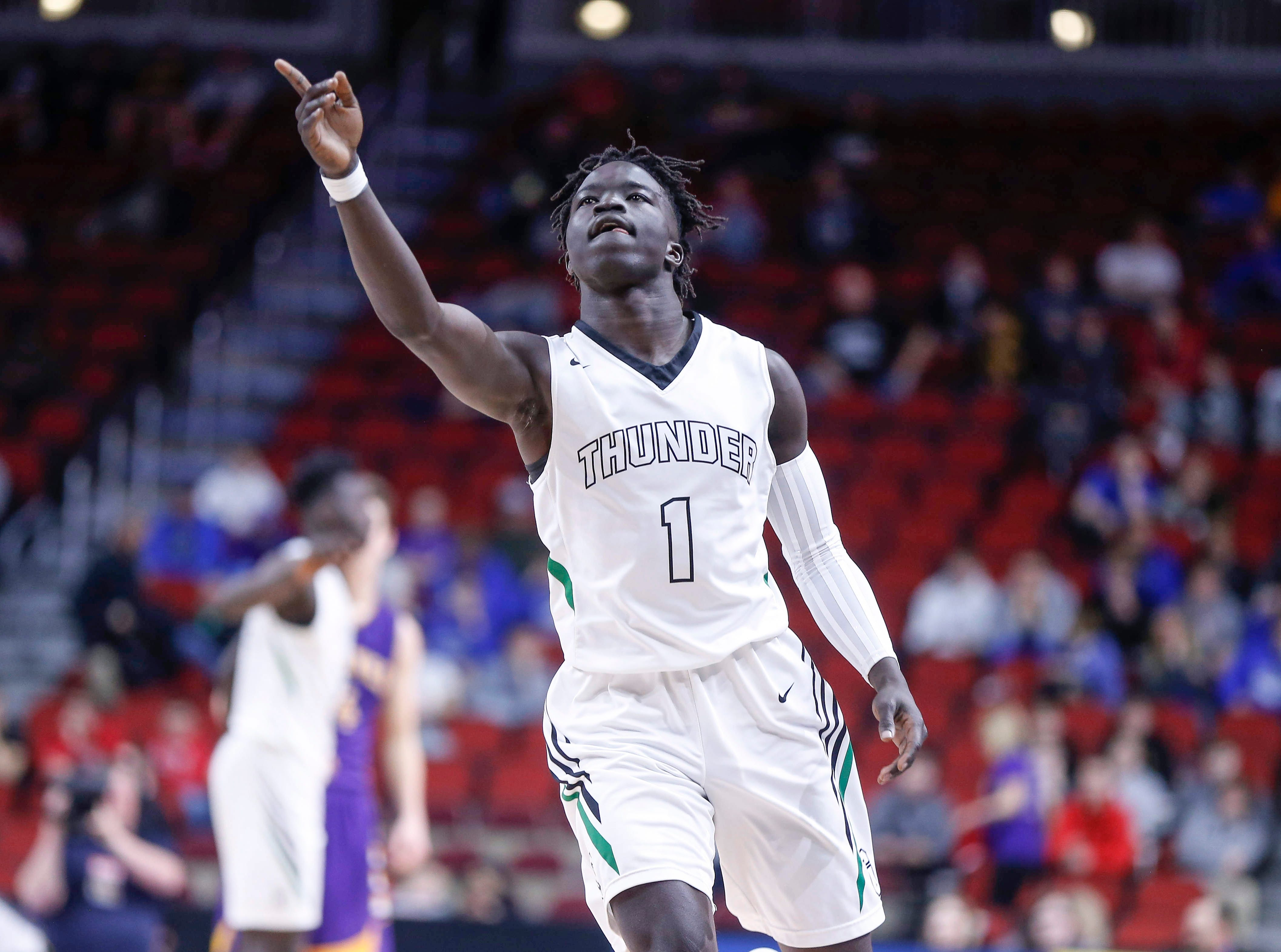 Grand View Christian senior Kong Neyail reacts after scoring a field goal in the fourth quarter against Alburnett during the Class 1A boys state basketball championship game on Friday, March 8, 2019, at Wells Fargo Arena in Des Moines.