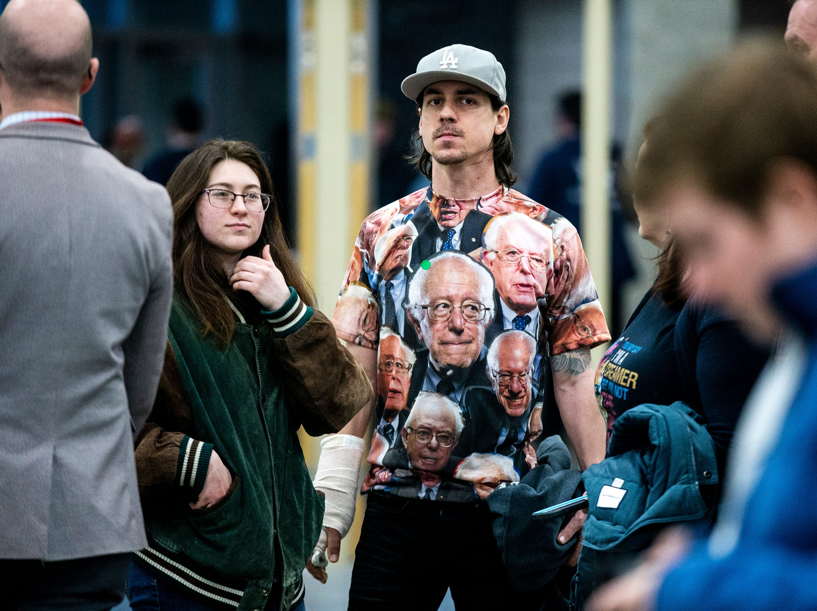 David Barba, 35 of Omaha, wears a shirt with Sen. Bernie Sanders, I-VT, face all over it to Sanders' first event in Iowa after announcing he'll run for president for the second time on Thursday, March 7, 2019, at the Mid-America Center in Council Bluffs.