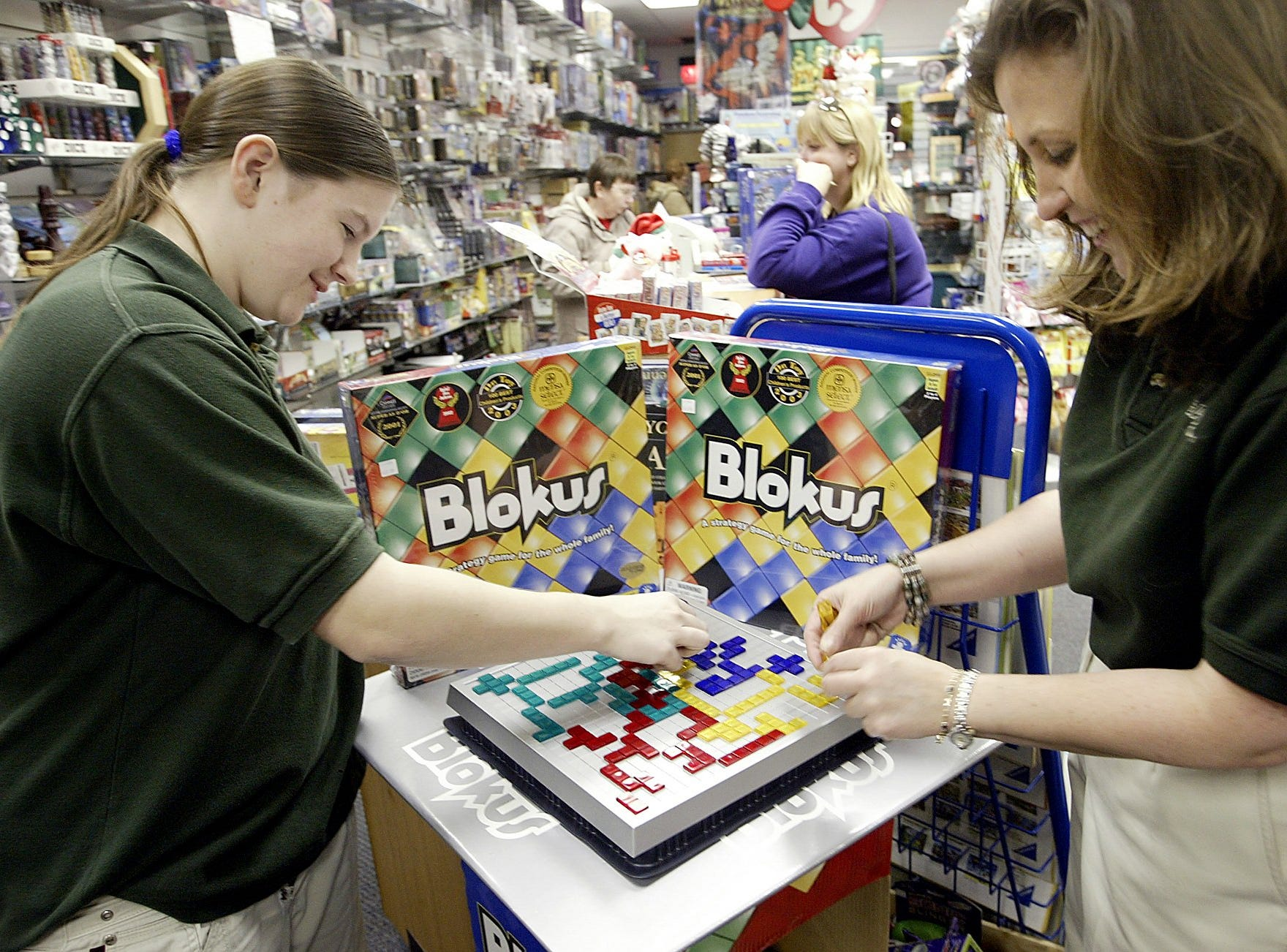 Corinne Harrison, manager of Games by James, and Keri McDonough, left, play a game at the store in the Valley West Mall in West Des Moines on Wednesday, Dec. 31, 2003.