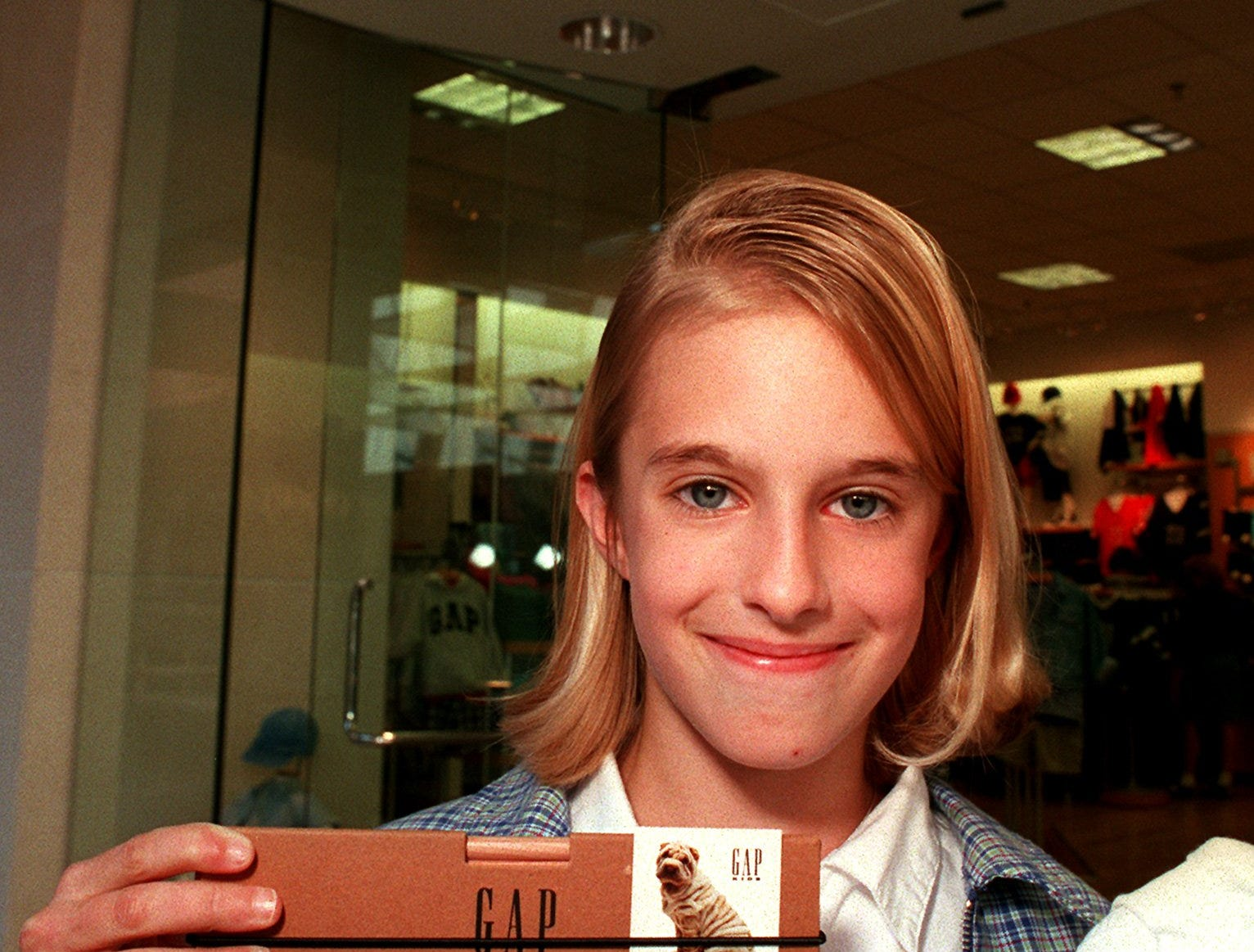 Ainslee Ericson, 11, holds a box of pencils and t-shirt after interviewing GapKids executive vice-president Ron Franks at the GapKids store at Valley West Mall. Ainslee, a 5th grader at Hanawalt, was conducting the interview for a school project on May 30, 1996.