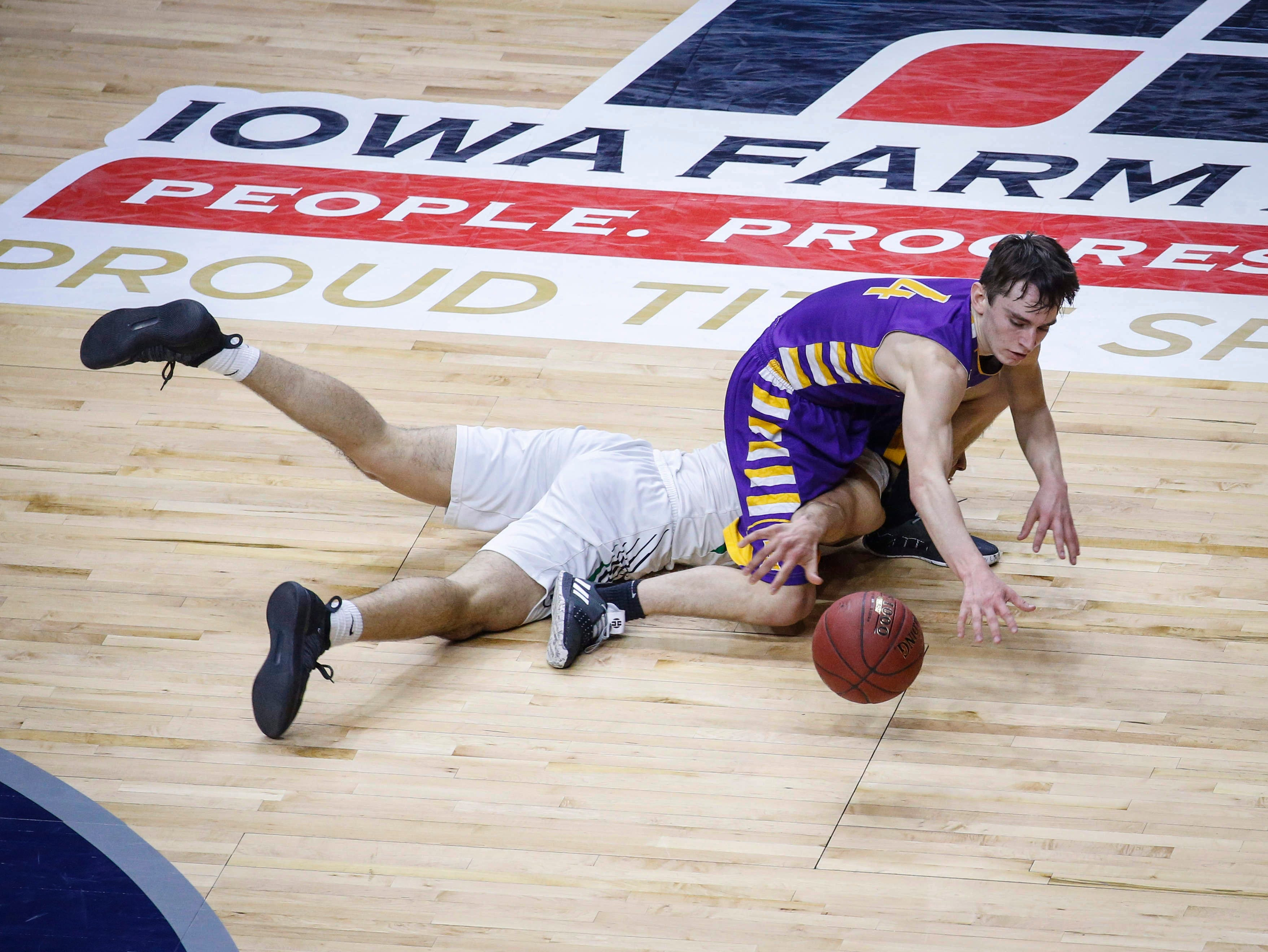 Alburnett senior Jared Graubard falls on top of Grand View Christian senior Arturo Montes as they fight for a loose ball in the first quarter during the Class 1A boys state basketball championship game on Friday, March 8, 2019, at Wells Fargo Arena in Des Moines.