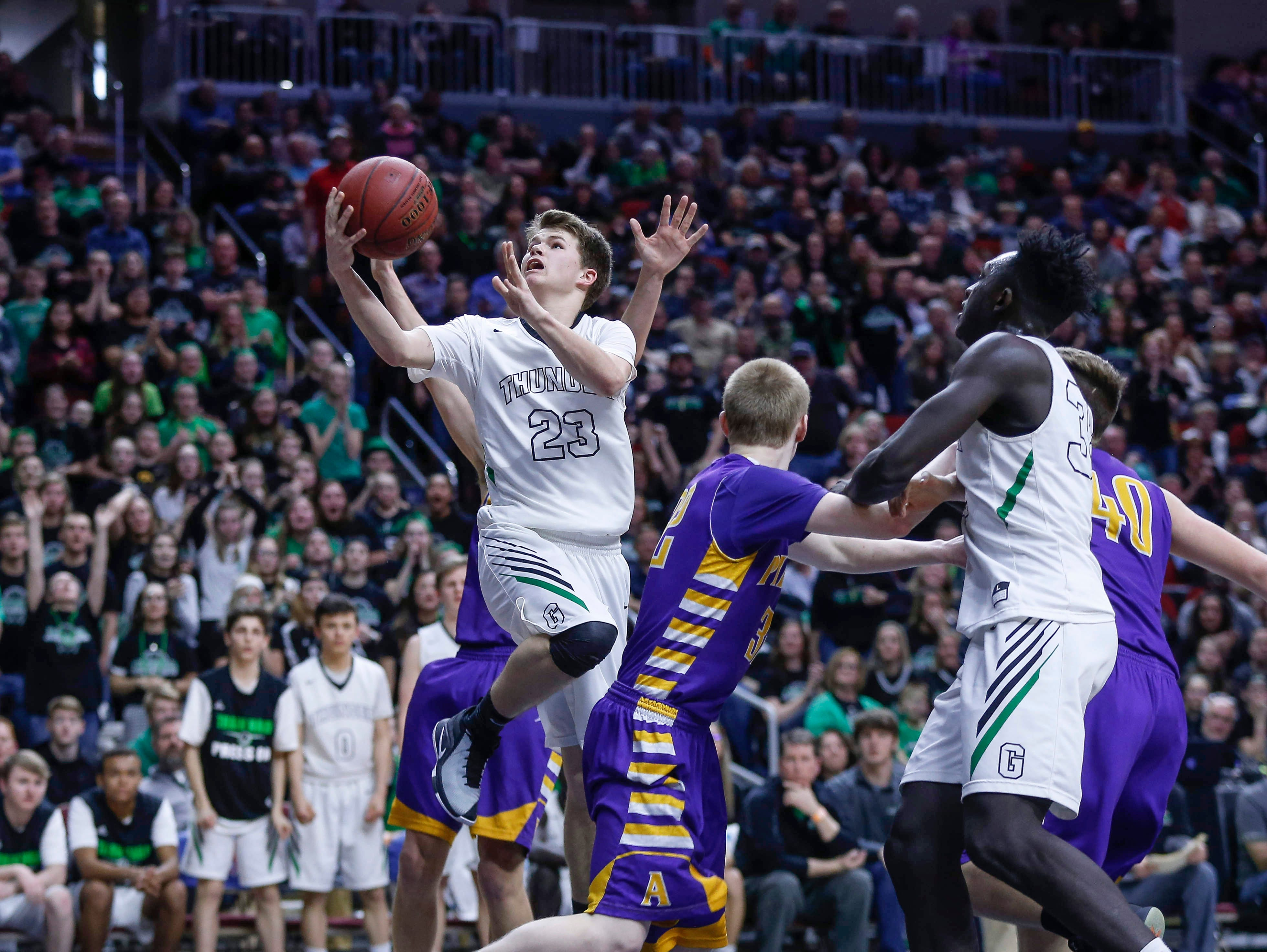 Grand View Christian senior Bryce Crabb drives up for an easy basket in the fourth quarter against Alburnett during the Class 1A boys state basketball championship game against Alburnett on Friday, March 8, 2019, at Wells Fargo Arena in Des Moines.