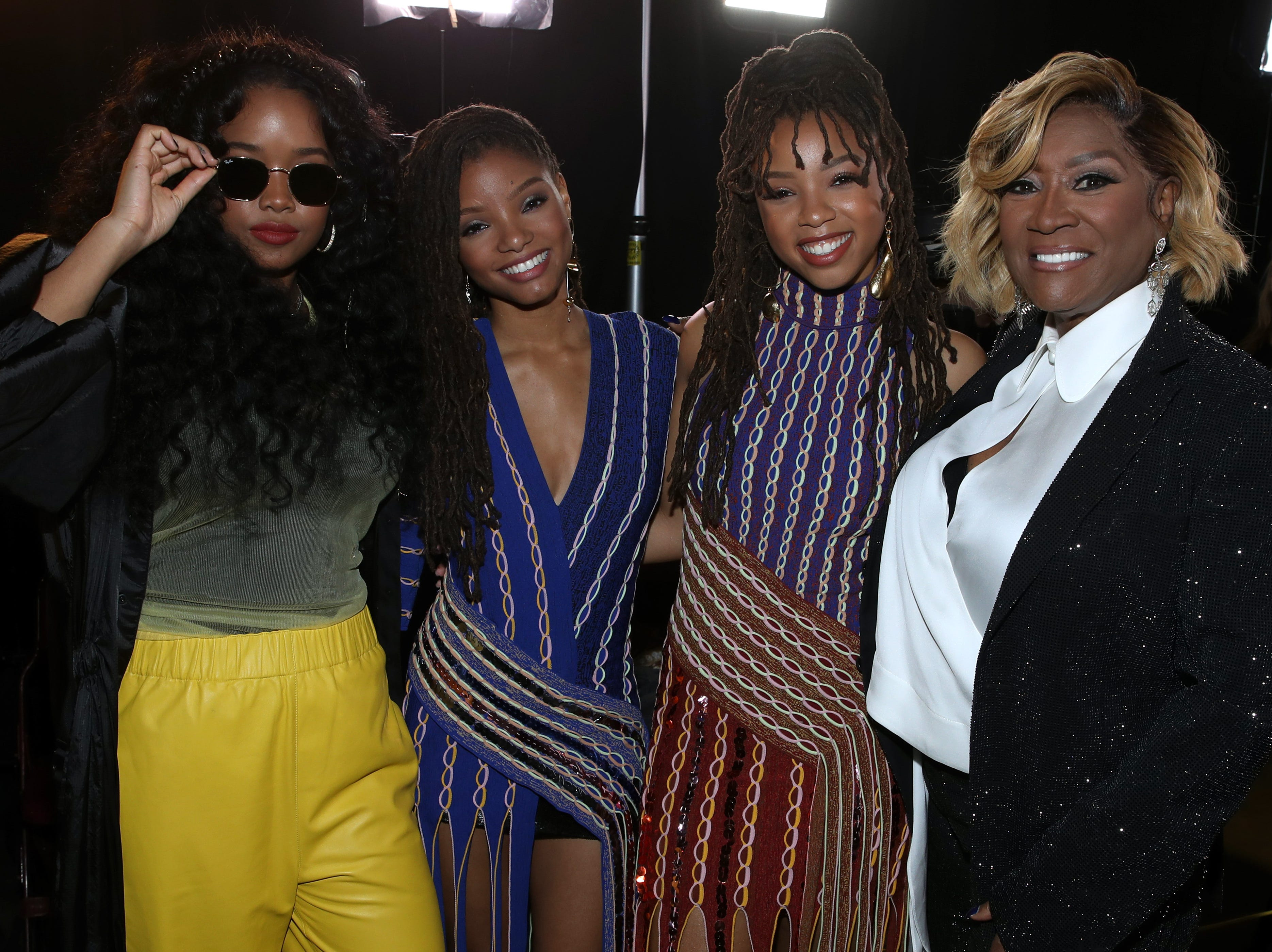"""LOS ANGELES, CA - JANUARY 13:  (L-R) H.E.R., Chloe X Halle and Patti LaBelle attend """"Aretha! A Grammy Celebration For the Queen Of Soul"""" at the Shrine Auditorium on Jan. 13, 2019, in Los Angeles, Calif."""