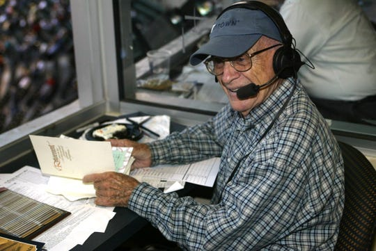 Detroit Tigers announcer Ernie Harwell in the broadcast booth Sept. 16, 2002, after leaving the game earlier to check on his wife, Lulu, who became ill during the Tigers celebration in his honor the day before.