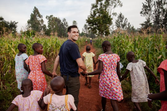 Detroit Tigers pitcher Matthew Boyd smiles as he walks through a cornfield in Uganda, where the Boyds have opened a non-profit aimed at ending child sex slavery.