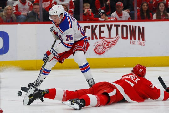 Detroit Red Wings defenseman Filip Hronek (17) blocks the shot of New York Rangers left wing Jimmy Vesey (26) during the first period of an NHL hockey game Thursday, March 7, 2019, in Detroit.