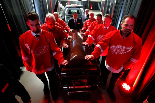 Pallbearers, clockwise from left, Dylan Larkin, Terry Zangkas, Al Sobotka, Jeff Lindsay, Lew LaPaugh, Mike Bayoff, Eddie Mio and Joey Kocur move the casket of former Detroit Red Wings player Ted Lindsay at a public viewing, Friday, March 8, 2019, in Detroit. Lindsay pioneered the first NHL hockey players' union despite intense opposition from team management, began the tradition of taking the Stanley Cup closer to fans by skating it around the ice and refused to attend his own Hall of Fame induction ceremony because only men were allowed. Lindsay died Monday at the age of 93.