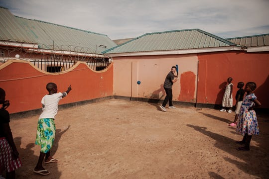 Detroit Tigers pitcher Matthew Boyd place baseball in a courtyard in Uganda, where the Boyds are trying to end child sex slavery.