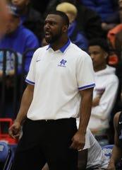 Ypsilanti Lincoln high school's head coach Jessie Davis on the bench during third quarter action against Novi Detroit Catholic Central high school in the regional final Thursday, March 7, 2019 at Ypsilanti Lincoln high school in Ypsilanti, Mich.