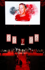 Mourners visit the casket of former Detroit Red Wings player Ted Lindsay at a public viewing, Friday, March 8, 2019, in Detroit. Lindsay pioneered the first NHL hockey players' union despite intense opposition from team management, began the tradition of taking the Stanley Cup closer to fans by skating it around the ice and refused to attend his own Hall of Fame induction ceremony because only men were allowed. Lindsay died Monday at the age of 93.