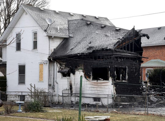 A home, damaged by a fire, is seen Friday, March 8, 2019, in Monroe, Mich.
