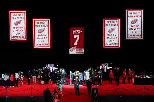 Mourners visit the casket of former Detroit Red Wings player Ted Lindsay at a public viewing, Friday, March 8, 2019, in Detroit.