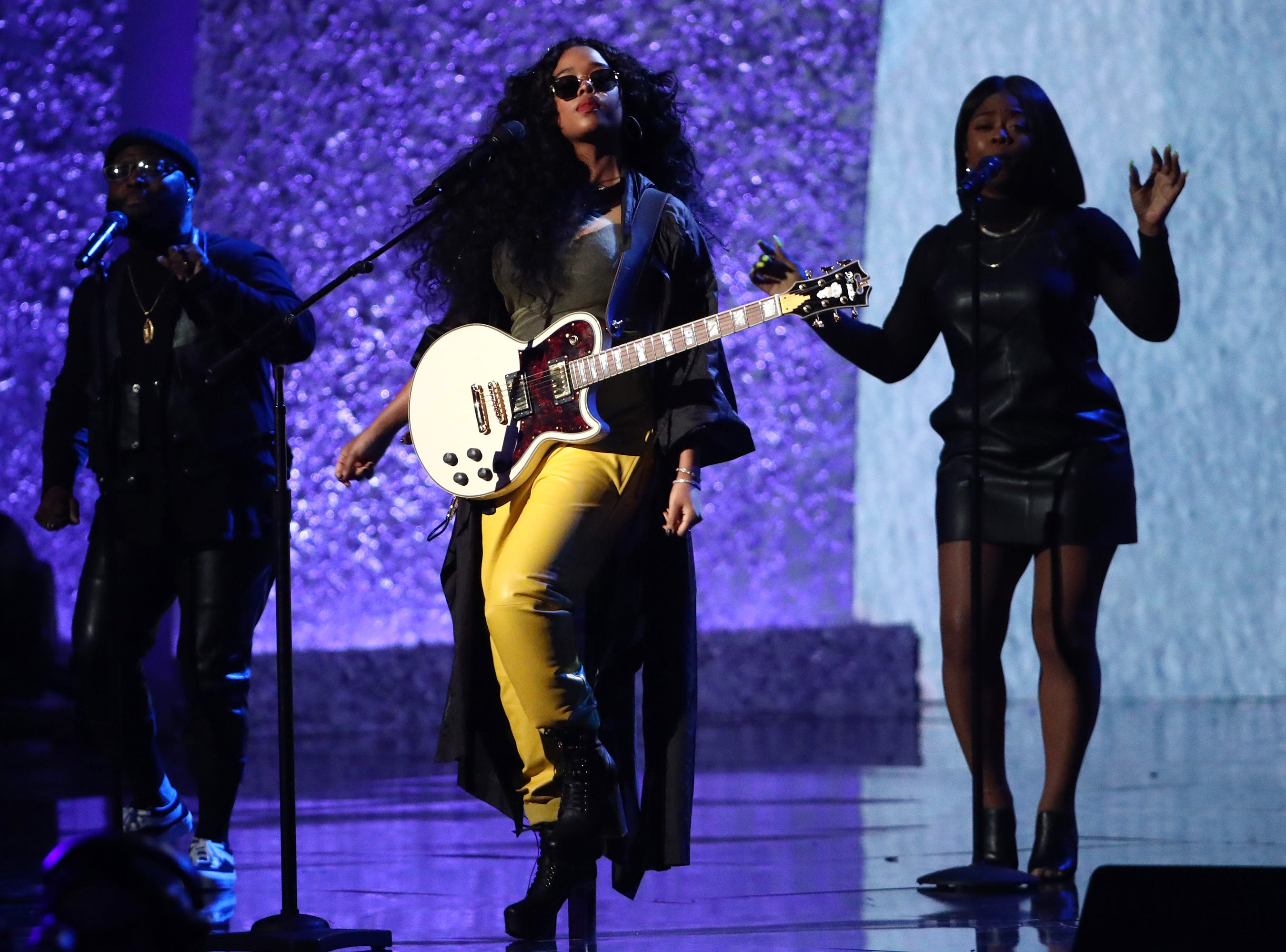 """LOS ANGELES, CA - JANUARY 13:  H.E.R. performs at """"Aretha! A Grammy Celebration For the Queen Of Soul"""" at the Shrine Auditorium on Jan. 13, 2019, in Los Angeles, Calif."""