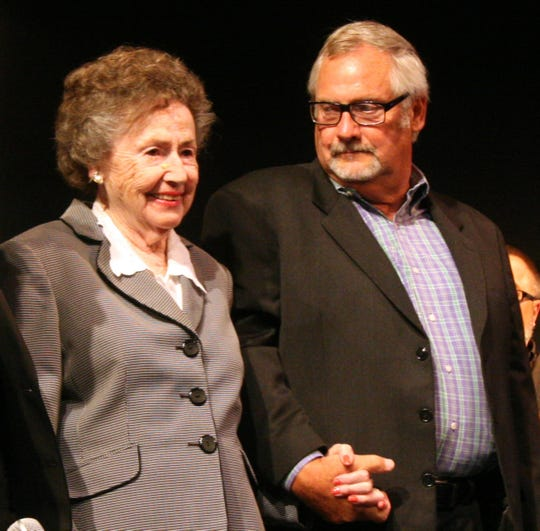 "Lulu Harwell, left, holds the hand of her son, Bill Harwell, at the City Theatre on Aug. 18, 2011, during the inaugural season of the two-man play ""Ernie,"" which depicted the life of legendary Detroit Tigers broadcaster Ernie Harwell.  Lulu Harwell, Ernie's widow, died at age 99 on March 1, 2019."