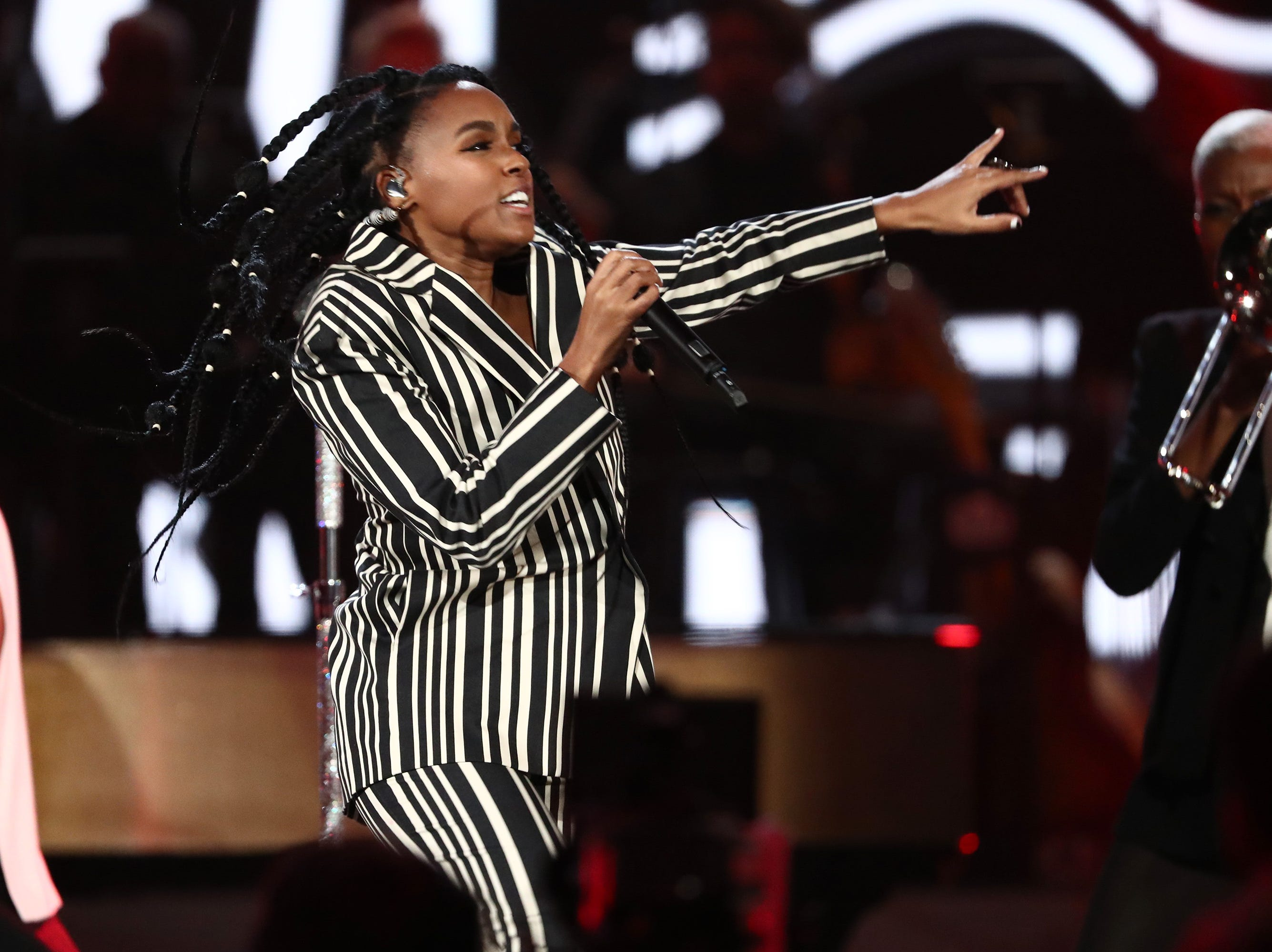 """LOS ANGELES, CA - JANUARY 13:  Janelle Monae performs at """"Aretha! A Grammy Celebration For the Queen Of Soul"""" at the Shrine Auditorium on Jan. 13, 2019, in Los Angeles, Calif."""