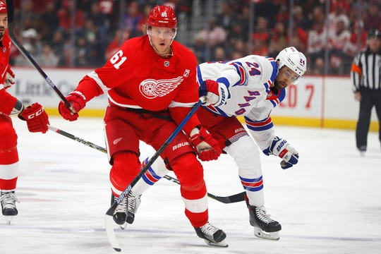 Detroit Red Wings center Jacob de la Rose (61) and New York Rangers center Boo Nieves (24) battle for the puck in the first period of an NHL hockey game Thursday, March 7, 2019, in Detroit.
