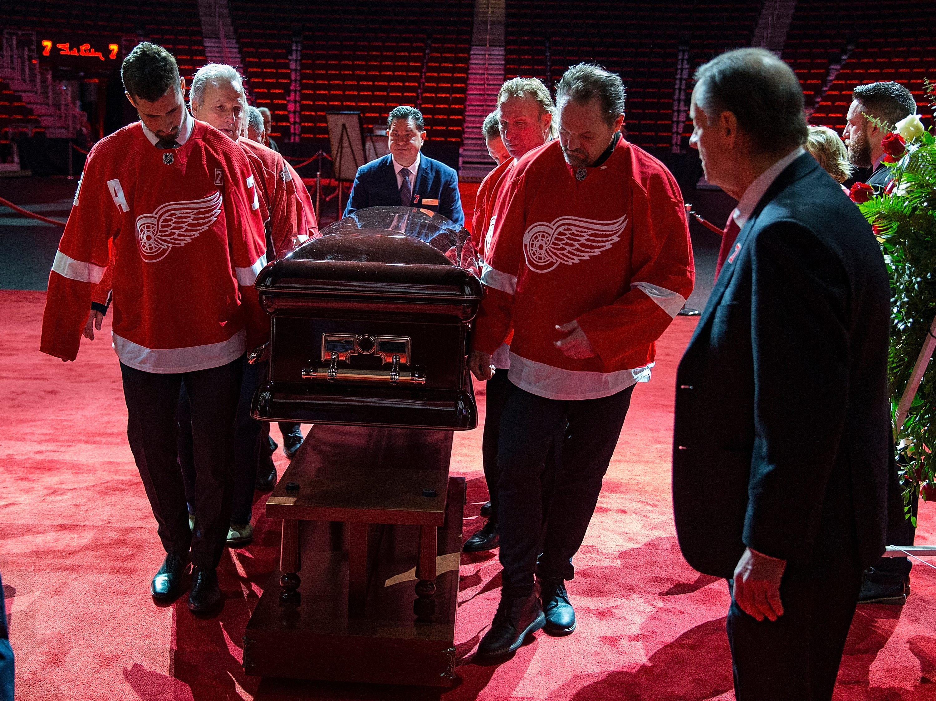 Pallbearers Dylan Larkin, left, and Joey Kocur, lead the casket ofTed Lindsay.